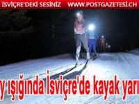 Ay ışığında İsviçre'de kayak yarışı